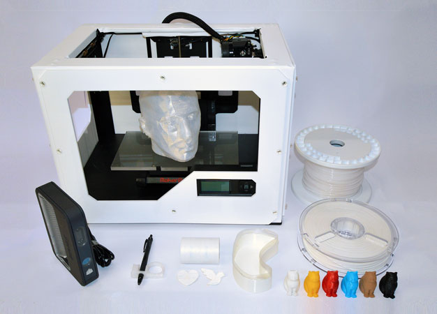 A 3D printer used by Keio researchers to digitally fabricate objects such as a pen holder and cranial model for nursing and healthcare.